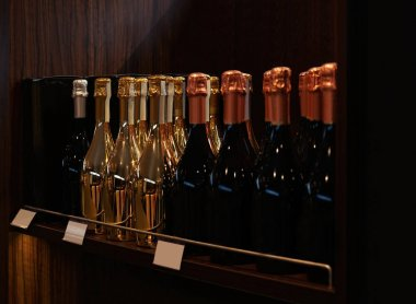 Wine bottles on wooden shelf
