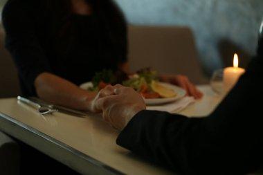 Couple hands in restaurant
