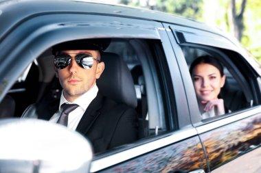 Businesswoman riding car