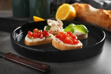 Tasty bruschetta on plate