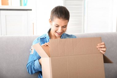 young woman opening box