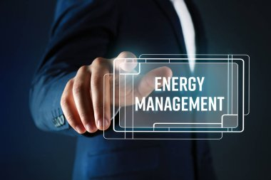 Man pushing ENERGY MANAGEMENT button