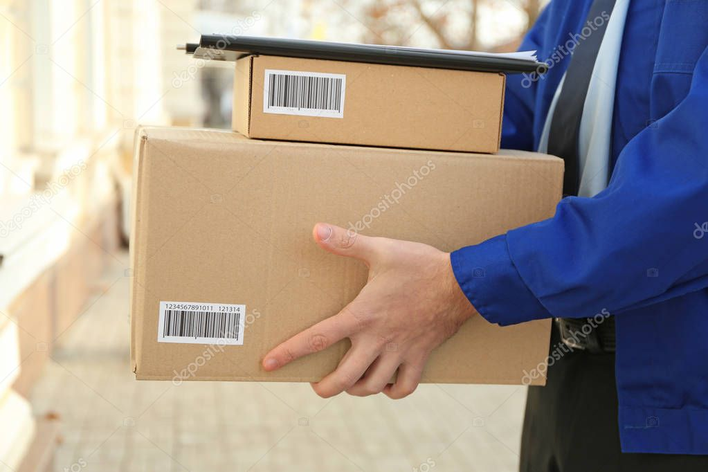 Courier with parcels on doorstep