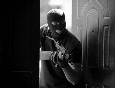 Thief with gun