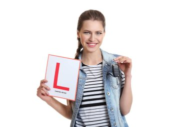 woman with learner driver sign