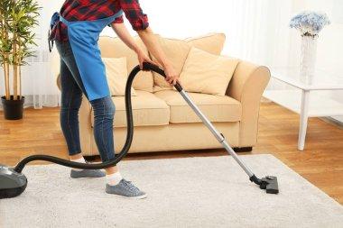 Cleaner hoovering carpet