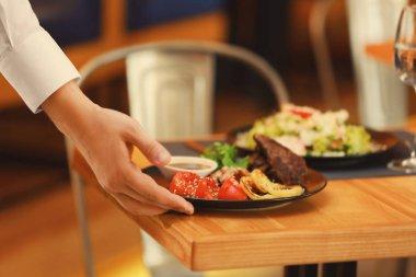 Waiter serving meals