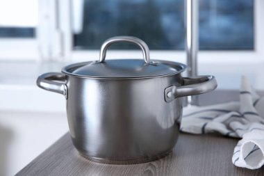 Stainless saucepan on table