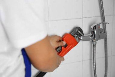 plumber fixing shower