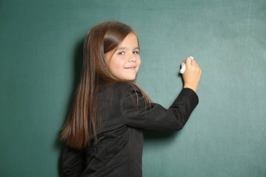 Little girl writing something