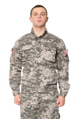 Soldier in camouflage on white