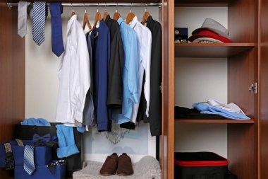 man's clothes in wardrobe