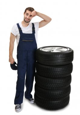 Young mechanic with wheels