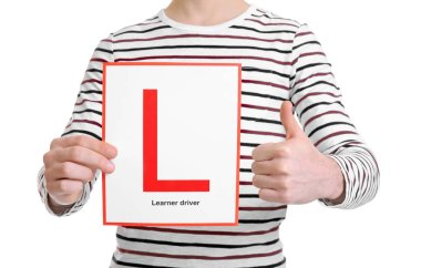 man with learner driver sign