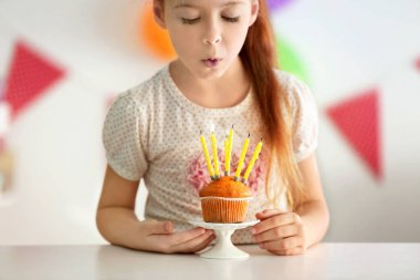 Cute little girl with birthday cake
