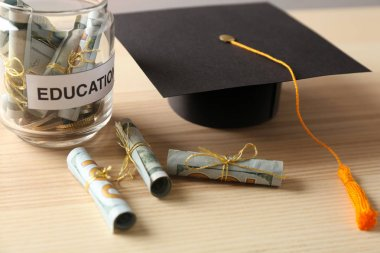 Graduation hat and jar with money