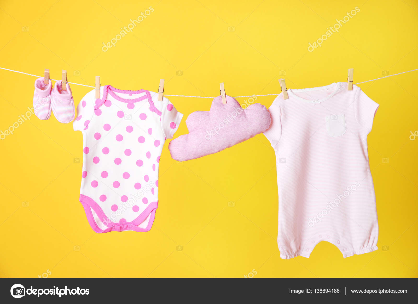 clothesline with hanging baby clothes stock photo belchonock