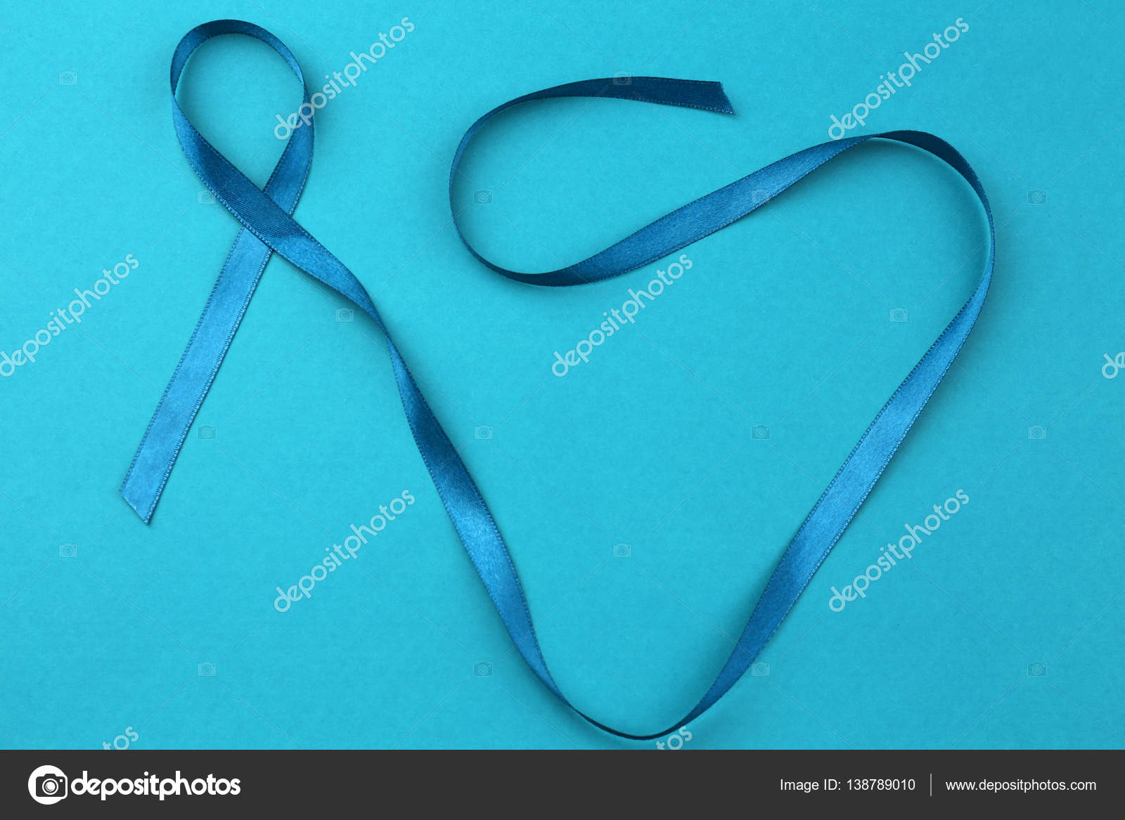 Ovarian cancer and gynecological disorders concept stock photo sea green ribbon on color background ovarian cancer and gynecological disorders concept photo by belchonock biocorpaavc