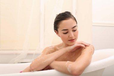 woman taking relaxing bath