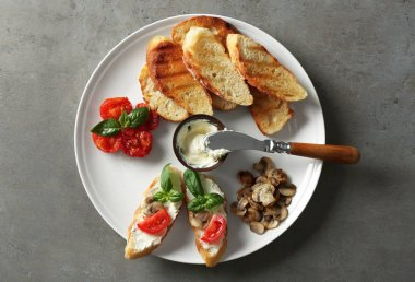 Tasty bruschettas on grey