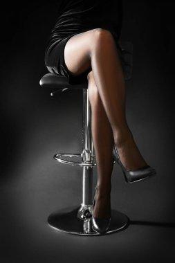 Beautiful woman legs in black tights