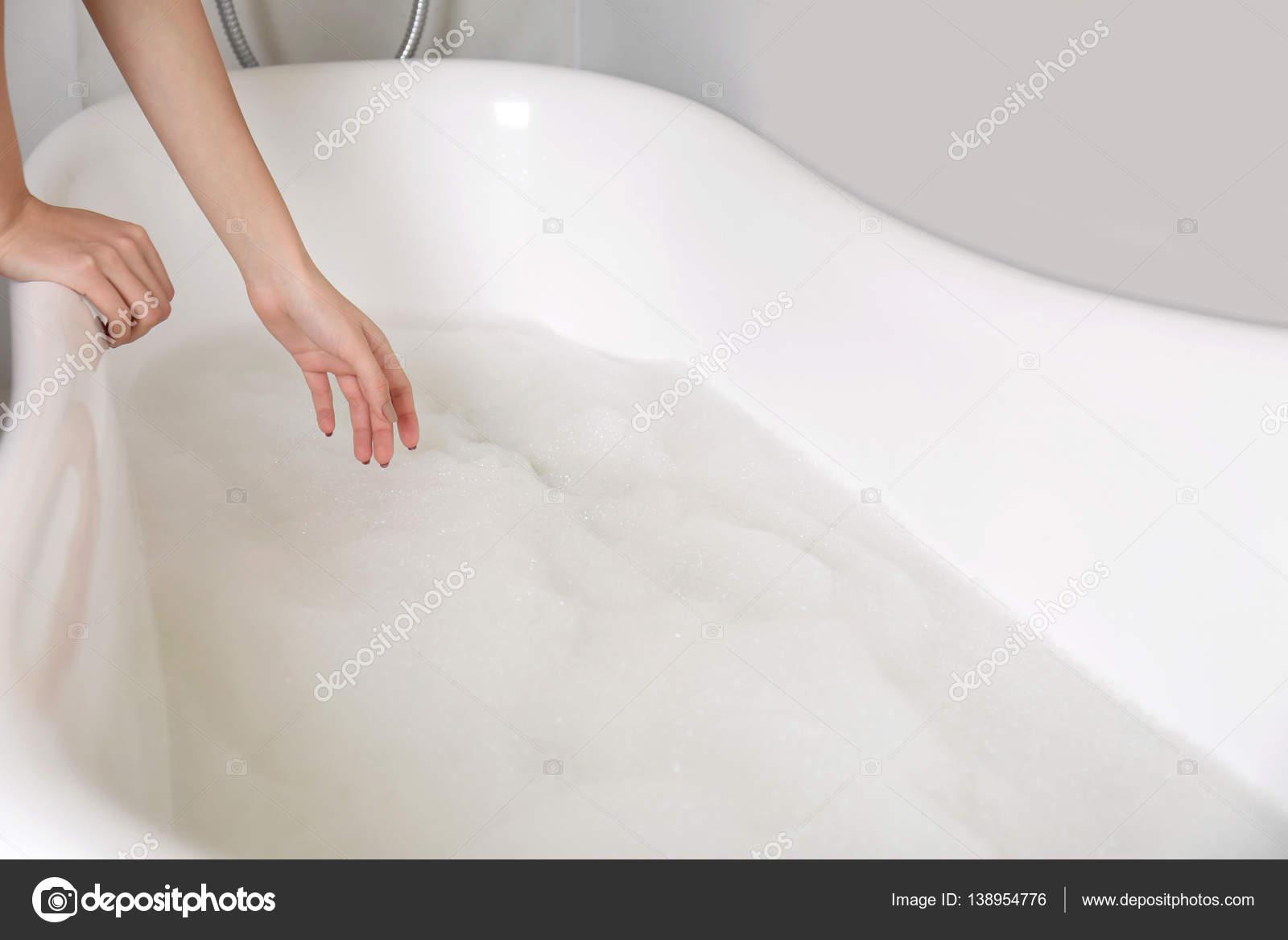 Woman making bubble bath — Stock Photo © belchonock #138954776