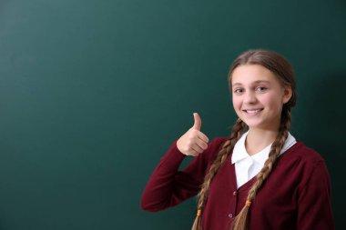 girl near green school blackboard
