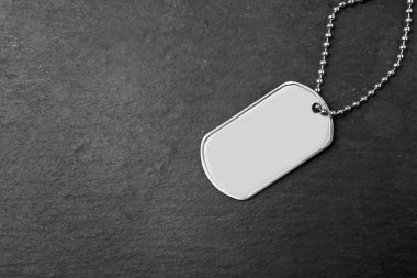Military ID tag on dark