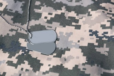Military ID tag on uniform