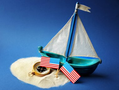 Wooden boat, USA flags and compass
