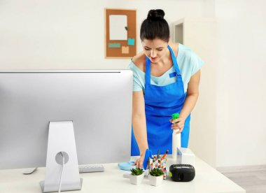 Young woman cleaning room