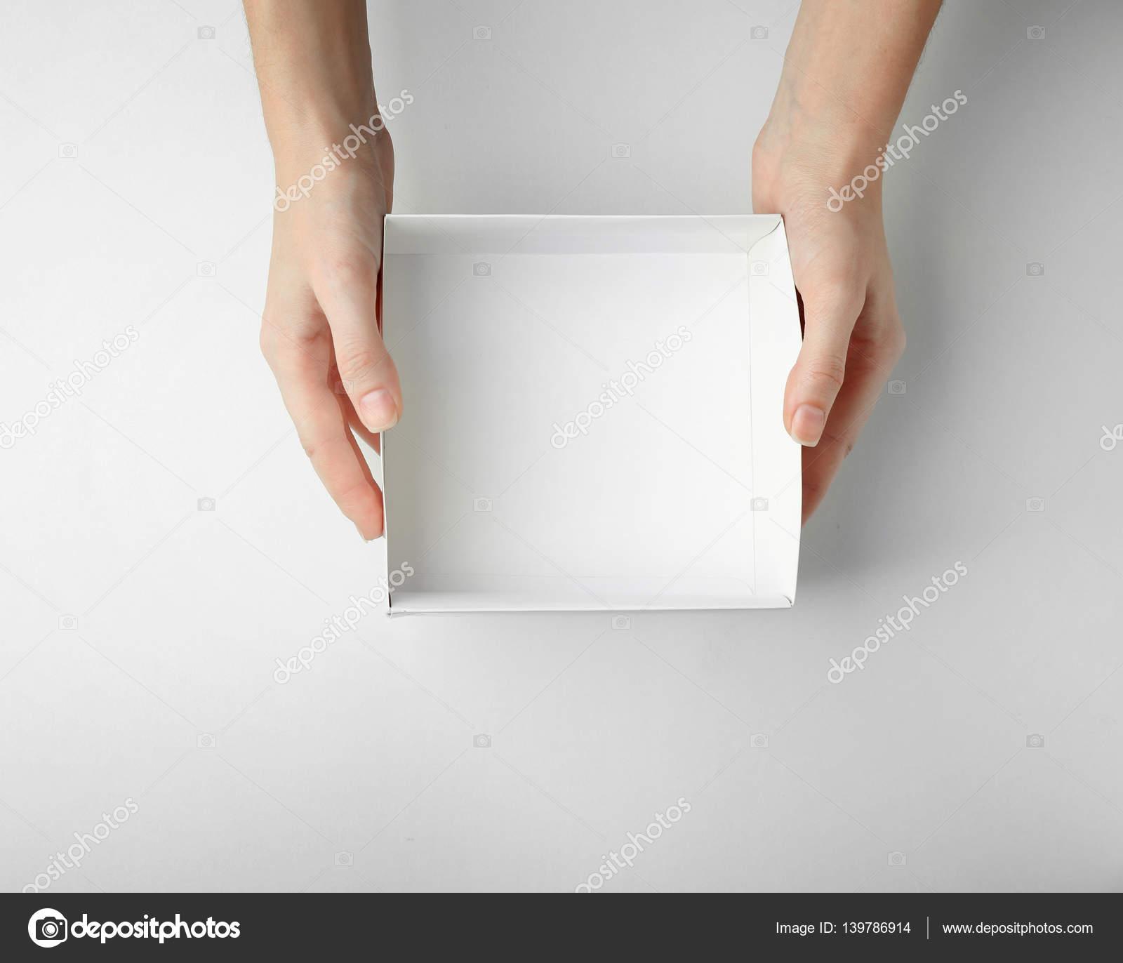 Female hands with open box — Stock Photo © belchonock #139786914