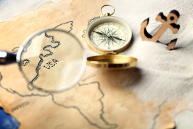 View at old map through magnifier