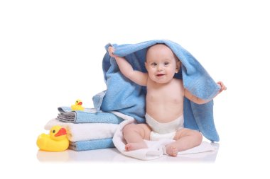 Cute baby with towels and ducks