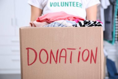 Female volunteer holding donation box