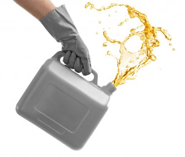Man pouring oil out of plastic canister