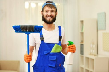 man with cleaning supplies