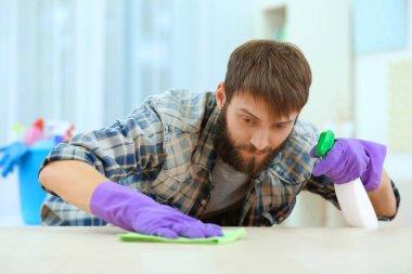 man cleaning furniture