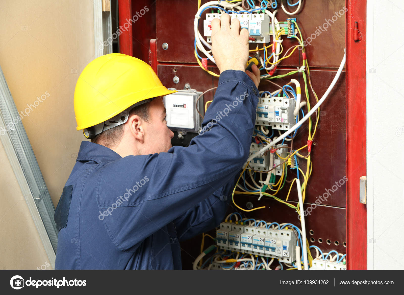 Electrician Connecting Wires In Distribution Board Stock Photo Wiring