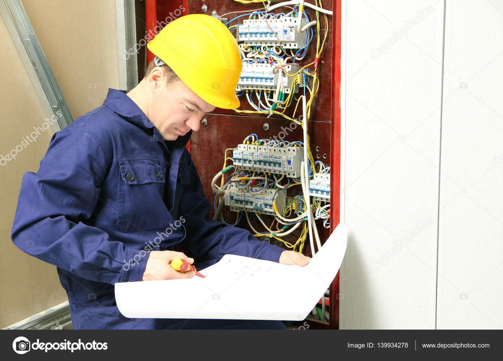 Electrician checking connections in distribution board according to electrician checking connections in distribution board according to wiring diagram stock photo asfbconference2016 Choice Image