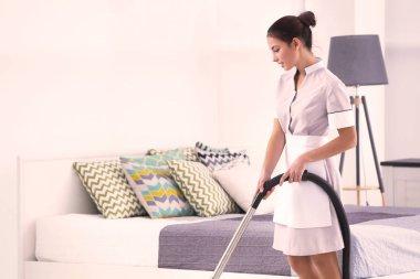 Hotel female chambermaid