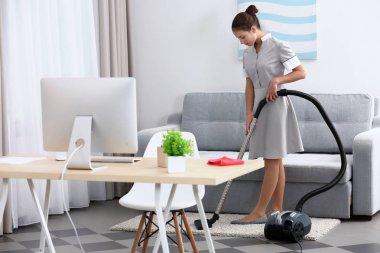 Female chambermaid with vacuum