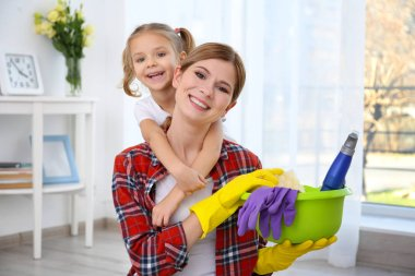 girl and mother with cleaning supplies