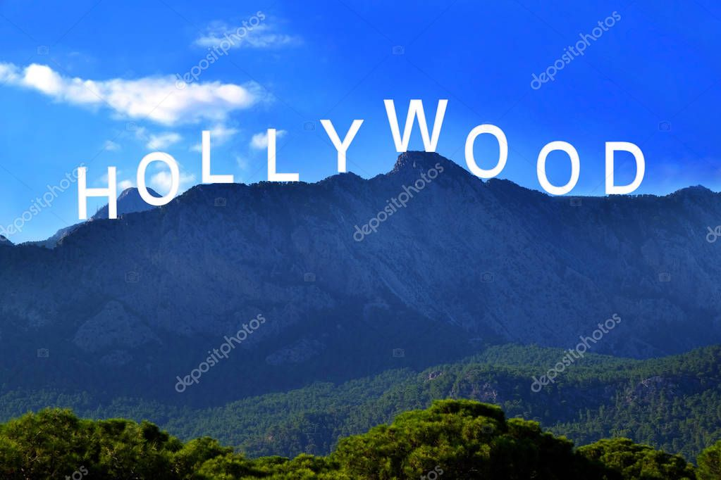 Word HOLLYWOOD over landscape