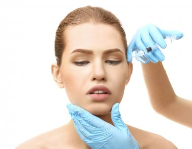 Young woman having cosmetic injection