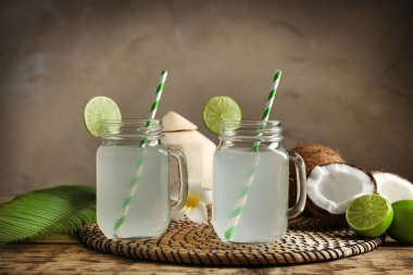 Two mason jars with coconut water