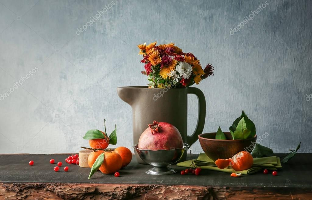 fruits and flowers on wooden table