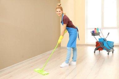 woman moping floor