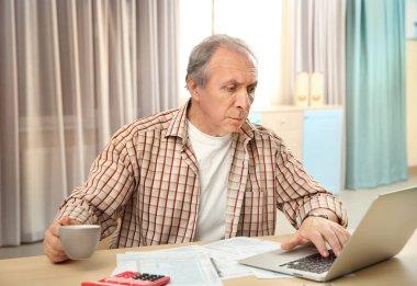 man calculating taxes