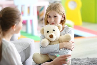female psychologist working with girl